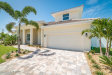 Photo of 120 Enclave Avenue, Indian Harbour Beach, FL 32937 (MLS # 862460)