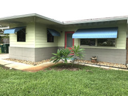 Photo of 720 Unity Drive, Indian Harbour Beach, FL 32937 (MLS # 887623)