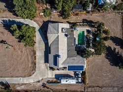 Photo of 9037 Joshua Road, Oak Hills, CA 92344 (MLS # 490771)