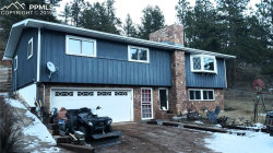 Photo of 217 Crystola Canyon Road, Woodland Park, CO 80863 (MLS # 8603959)