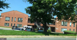 Photo of 19650 Club House ROAD, Unit 203, Gaithersburg, MD 20886 (MLS # 1009917744)