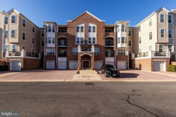 Photo of 8608 Fluttering Leaf TRAIL, Unit 104, Odenton, MD 21113 (MLS # MDAA423538)
