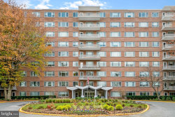 Photo of 11 Slade Ave, Unit 711, Baltimore, MD 21208 (MLS # MDBC477888)