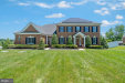 Photo of 6812 Koandah Gardens, Highland, MD 20777 (MLS # MDHW265524)