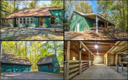 Photo of 7457 Mink Hollow ROAD, Highland, MD 20777 (MLS # MDHW271200)