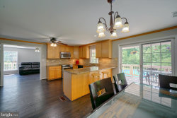 Photo of 4754 Woodland ROAD, Ellicott City, MD 21042 (MLS # MDHW274380)