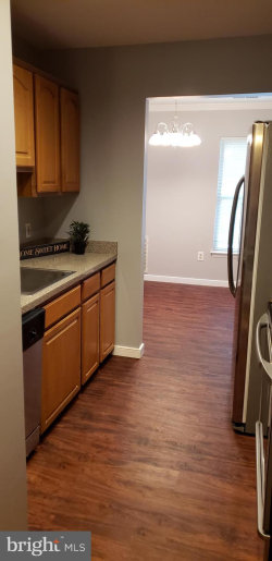 Photo of 18503 Sweet Autumn DRIVE, Unit 304, Gaithersburg, MD 20879 (MLS # MDMC665538)