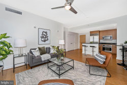 Photo of 6820 Wisconsin AVENUE, Unit 8008, Bethesda, MD 20815 (MLS # MDMC729368)