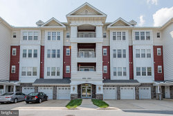 Photo of 13851 Belle Chasse BOULEVARD, Unit 313, Laurel, MD 20707 (MLS # MDPG575472)