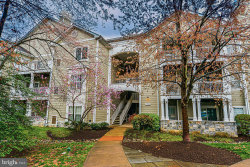 Photo of 1700 Lake Shore Crest DRIVE, Unit 31, Reston, VA 20190 (MLS # VAFX1119456)