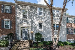 Photo of 3902 Golf Tee COURT, Unit 102, Fairfax, VA 22033 (MLS # VAFX1159748)