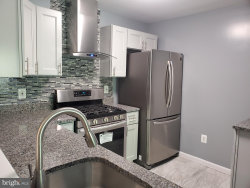 Photo of 18825 Sparkling Water DRIVE, Unit 1-F, Germantown, MD 20874 (MLS # MDMC709652)