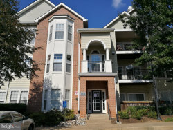 Photo of 4142 Fountainside LANE, Unit E204, Fairfax, VA 22030 (MLS # VAFX1090890)