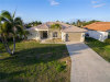 Photo of 2309 SW 51st ST, CAPE CORAL, FL 33914 (MLS # 218014321)