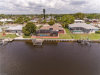 Photo of 1703 Lakeside TER, NORTH FORT MYERS, FL 33903 (MLS # 218028407)