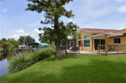 Photo of 1746 Club House RD, NORTH FORT MYERS, FL 33917 (MLS # 218045701)