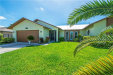 Photo of 619 SE 2nd AVE, CAPE CORAL, FL 33990 (MLS # 218047486)