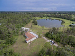 Photo of 10660 Sharon DR, NORTH FORT MYERS, FL 33917 (MLS # 218047693)