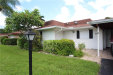 Photo of 859 Pangola DR, NORTH FORT MYERS, FL 33903 (MLS # 218050055)