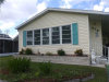 Photo of 516 Timber S LN, NORTH FORT MYERS, FL 33917 (MLS # 218054084)