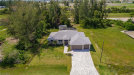 Photo of 1128 NW 27th CT, CAPE CORAL, FL 33993 (MLS # 218066072)