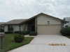 Photo of 9861 Wildginger DR, FORT MYERS, FL 33919 (MLS # 218075810)