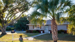 Photo of 1881 N EVALENA LN, NORTH FORT MYERS, FL 33917 (MLS # 218080638)
