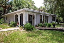 Photo of 10951 Ruden RD, NORTH FORT MYERS, FL 33917 (MLS # 219011488)