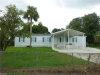 Photo of 8239 Tolles DR, NORTH FORT MYERS, FL 33917 (MLS # 219014131)