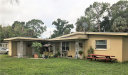 Photo of 226 Crescent Lake DR, NORTH FORT MYERS, FL 33917 (MLS # 219045058)