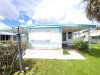 Photo of 624 Vista DR, NORTH FORT MYERS, FL 33917 (MLS # 219053334)