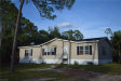 Photo of 8373 Barbie LN, NORTH FORT MYERS, FL 33917 (MLS # 219058447)