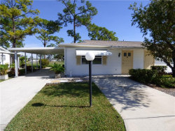 Photo of 37 Pinewood BLVD, LEHIGH ACRES, FL 33936 (MLS # 219068761)