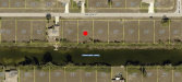 Photo of 322 NW 20th TER, CAPE CORAL, FL 33993 (MLS # 218013801)