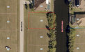 Photo of 301 NW 26th PL, CAPE CORAL, FL 33993 (MLS # 220039347)