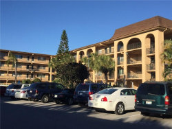 Photo of 2525 W Bay Drive, Unit E20, BELLEAIR BLUFFS, FL 33770 (MLS # C7238652)