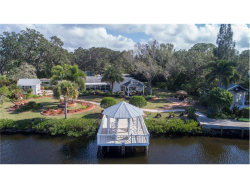Photo of 220 S Oxford Drive, ENGLEWOOD, FL 34223 (MLS # D5921579)