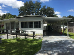 Photo of 5033 Little Lake Court, ZEPHYRHILLS, FL 33542 (MLS # T2899026)