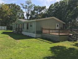 Photo of 4115 Mitchell Road, LAND O LAKES, FL 34638 (MLS # T2900568)