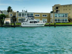 Photo of 210 Dolphin Point, Unit C, CLEARWATER BEACH, FL 33767 (MLS # U7821986)