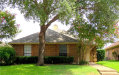Photo of 2119 Falcon Ridge Drive, Carrollton, TX 75010 (MLS # 13676427)