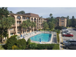 Photo of 2525 W Bay Drive C31, Unit C31, BELLEAIR BLUFFS, FL 33770 (MLS # U7827630)