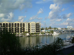 Photo of 255 Dolphin Point, Unit 414, CLEARWATER BEACH, FL 33767 (MLS # U7829634)