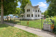 Photo of 94 E Maple Street, Cedar Springs, MI 49319 (MLS # 20029241)