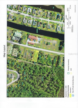 Photo of 243 Boundary Boulevard, ROTONDA WEST, FL 33947 (MLS # D6114042)