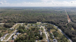 Photo of 13065 Morris Bridge Road, THONOTOSASSA, FL 33592 (MLS # T3227044)