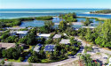 Photo of 454 Firehouse Court, LONGBOAT KEY, FL 34228 (MLS # A4421082)