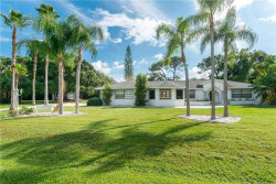 Photo of 1884 Whispering Pines Circle, ENGLEWOOD, FL 34223 (MLS # D6109194)