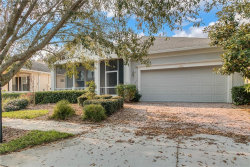 Photo of 119 Crepe Myrtle Dr, GROVELAND, FL 34736 (MLS # G5027038)