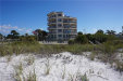 Photo of 4510 Gulf Boulevard, Unit 401, ST PETE BEACH, FL 33706 (MLS # J906197)